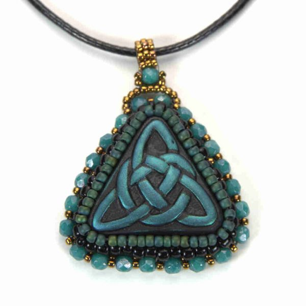 Blue celtic trinity knot pendant with turquoise and gold bezel and bail