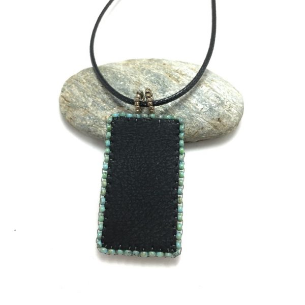 back of faux leather pendant