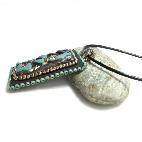 side of faux leather patina pendant